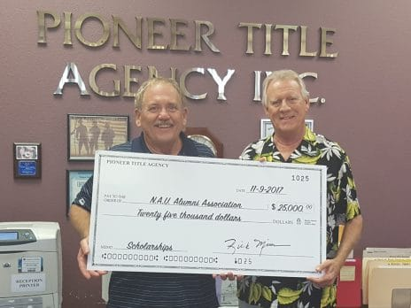 Donors from Pioneer Title Agency award check to NAU-Yuma