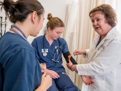 Professor demonstrating how to perform nursing procedures