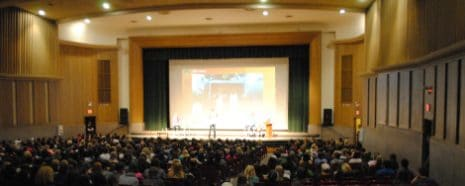 NAU auditorium filled with people watching a performance.