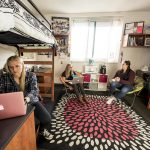 NAU students hanging out in their dorm room.